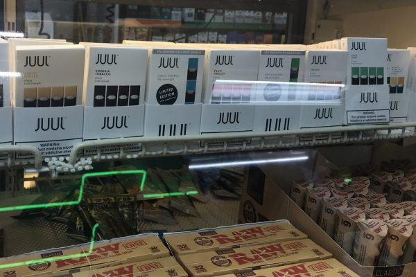 JUUL packages lined up at a store