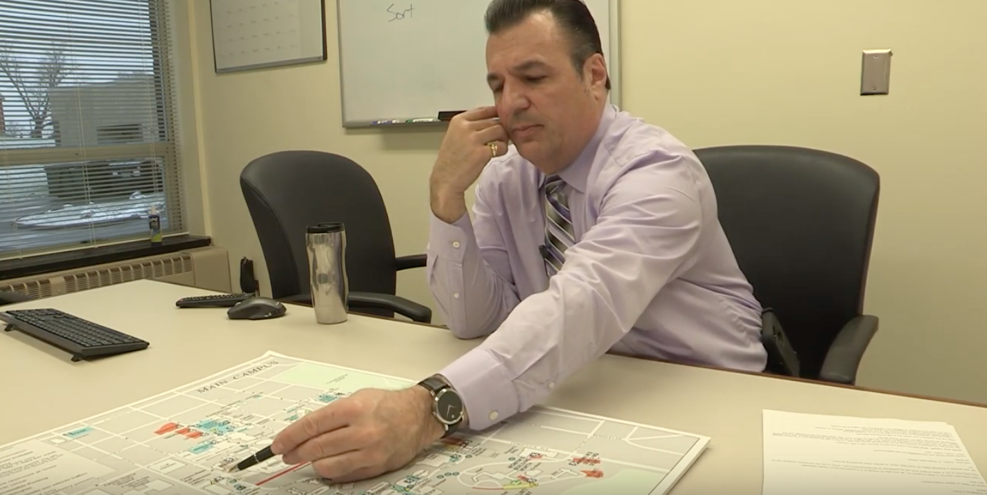 Joseph J. Carfi points to a map of Syracuse University's main campus.