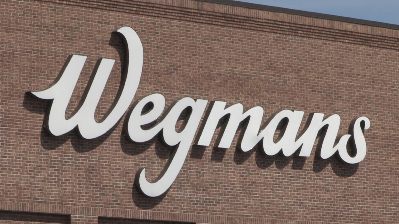 The wegmans logo on the DeWitt store building.